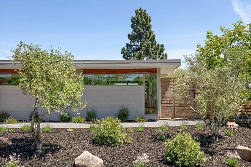 The home's renovation went from the outside in, and included new plantings, fencing and a stone walkway from the side of the garage into the spacious side and backyards.