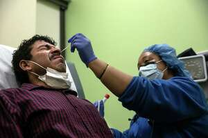 A nurse gives a Guatemalan immigranta COVID-19 swab test at a clinic on May 5, 2020 in Stamford, Connecticut.