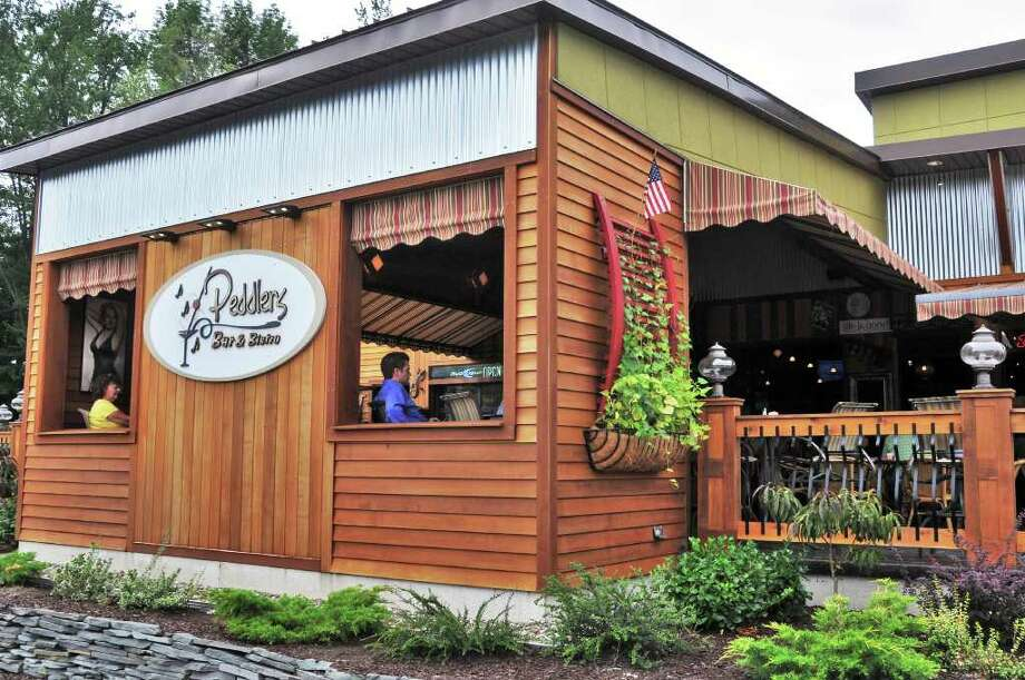 Peddlers Bar and Bistro, in Clifton Park, offers a patio, karaoke stage, large bar and dance floor. (John Carl D'Annibale / Times Union) Photo: John Carl D'Annibale / 00009891A