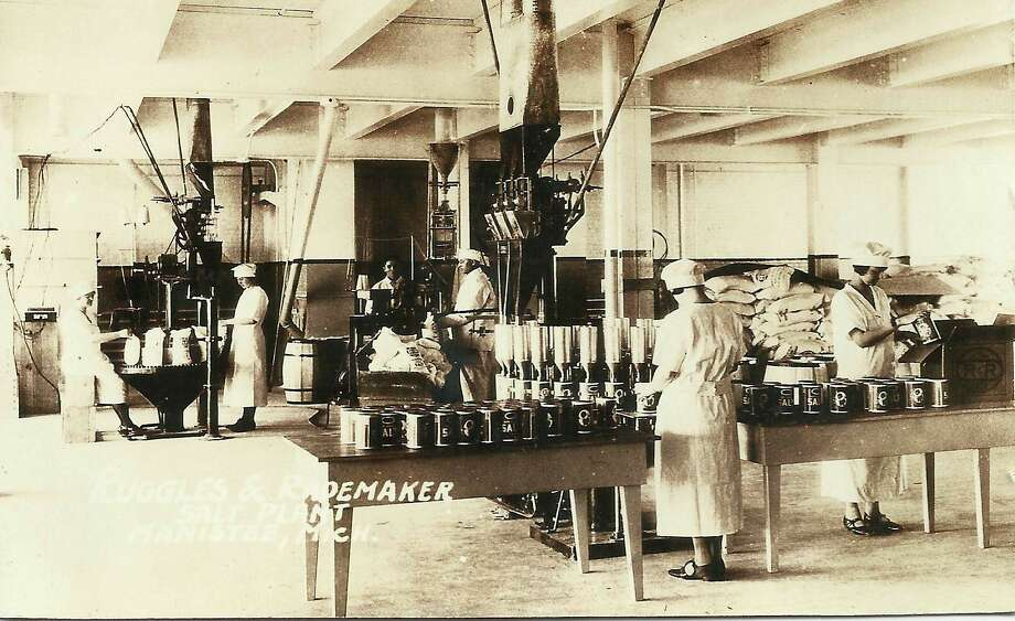 Workers at the Ruggles and Rademaker Salt plant process cans of the product, circa 1900.