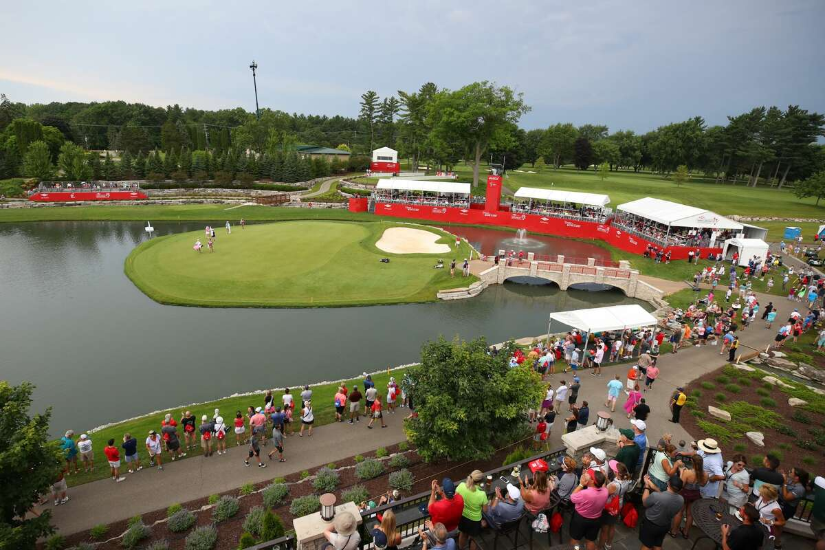 FILE - Fans are shown around the island green of the 18th hole during the inaugural Dow Great Lakes Bay Invitational at the Midland Country Club in 2019.
