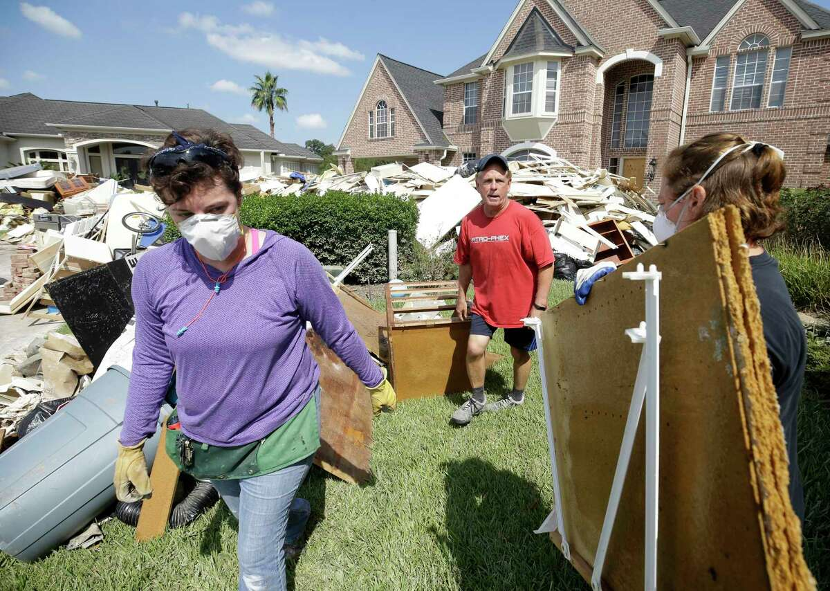 Tom Mayne, center, a member of Champion Forest Baptist, 15555 Stuebner Airline Rd., works with a crew from his church who are helping him with cleanup Tuesday, Sept. 5, 2017, in Houston from the aftermath of flood following Hurricane Harvey.