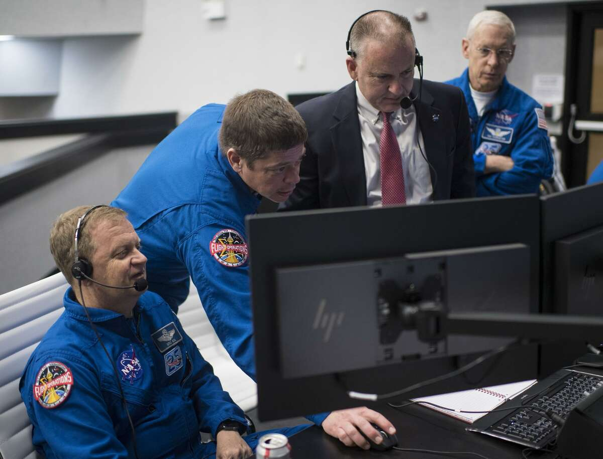 NASA astronaut Eric Boe, assistant to the chief of the astronaut office for Commercial Crew, left, NASA astronaut Bob Behnken, Norm Knight, deputy director of flight operations, and Pat Forrester, chief of the astronaut office, monitor the countdown of the launch of a SpaceX Falcon 9 rocket carrying the company's Crew Dragon spacecraft on the Demo-1 mission on March 2, 2019, at the Kennedy Space Center in Florida. The Demo-1 mission was an uncrewed launch to the International Space Station. NASA and SpaceX are now preparing to launch astronauts on May 27.