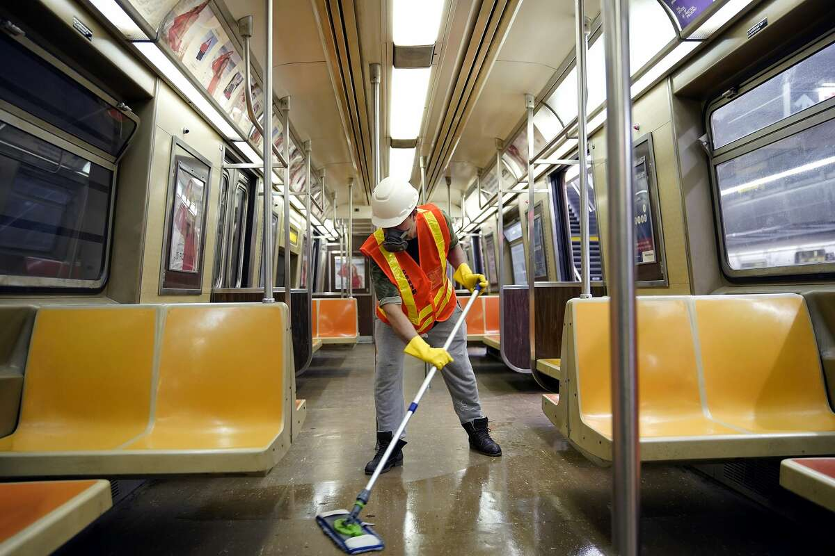 A cleaning contractor disinfects a New York City subway car , in New York, United States, on May 5, 2020. New York State Governor Andrew Cuomo ordered that the subway system be shut down between 1am and 5am as an added measure to combat the COVOD-19 pandemic. (Photo by John Lamparski/NurPhoto via Getty Images)