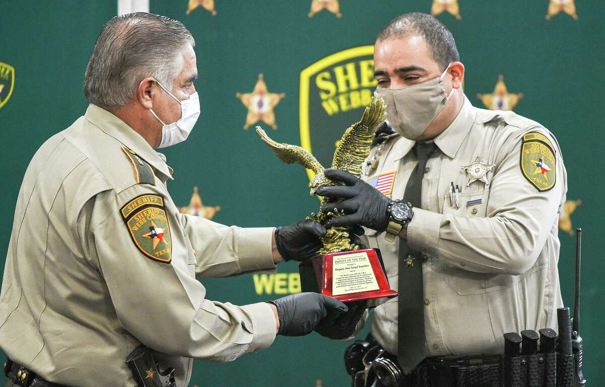 Webb County Sheriff Martin Cuellar presents the Deputy of the Year award to Deputy Jose Israel Sanchez, Thursday, May 14, 2020, during a National Law Enforcement Week presentation recognizing local law enforcement agencies, individuals and departments supporting them.