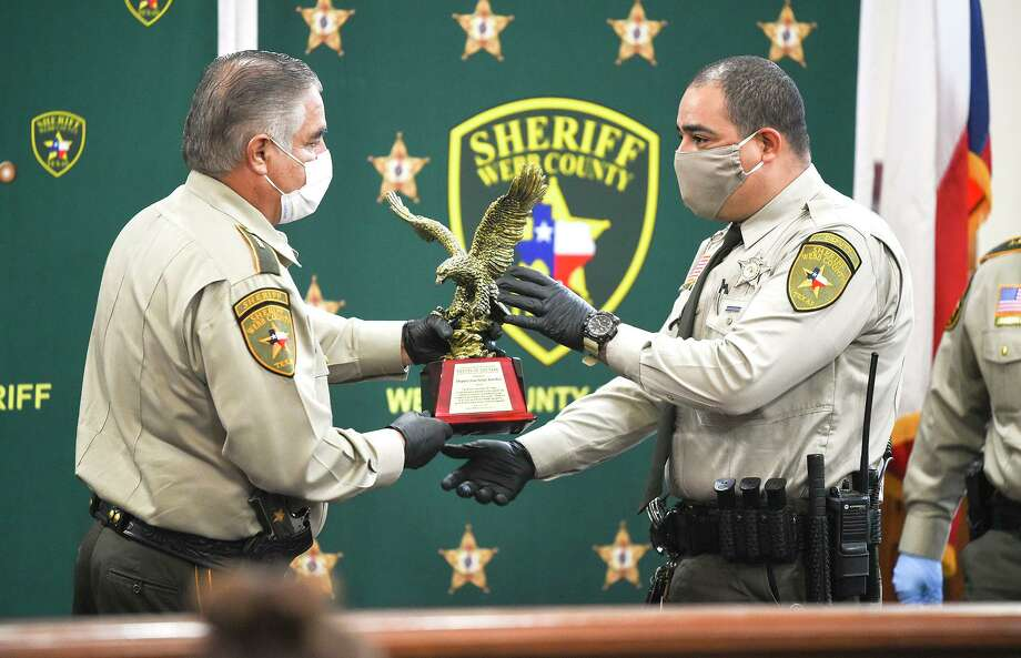 Webb County Sheriff Martin Cuellar presents the Deputy of the Year award to Deputy Jose Israel Sanchez on Thursday during a National Law Enforcement Week presentation recognizing local law enforcement agencies, individuals and departments supporting them. Photo: Danny Zaragoza / Laredo Morning Times