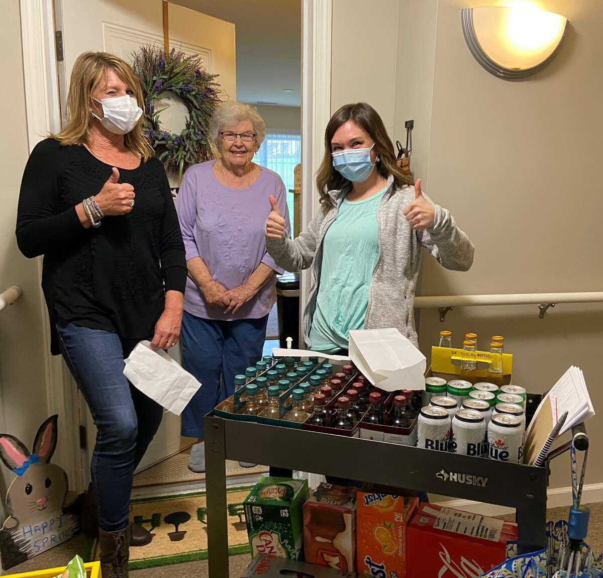 Kelly Hotaling, left, and Tarah Lobdell with Summit at Eastwyck resident.