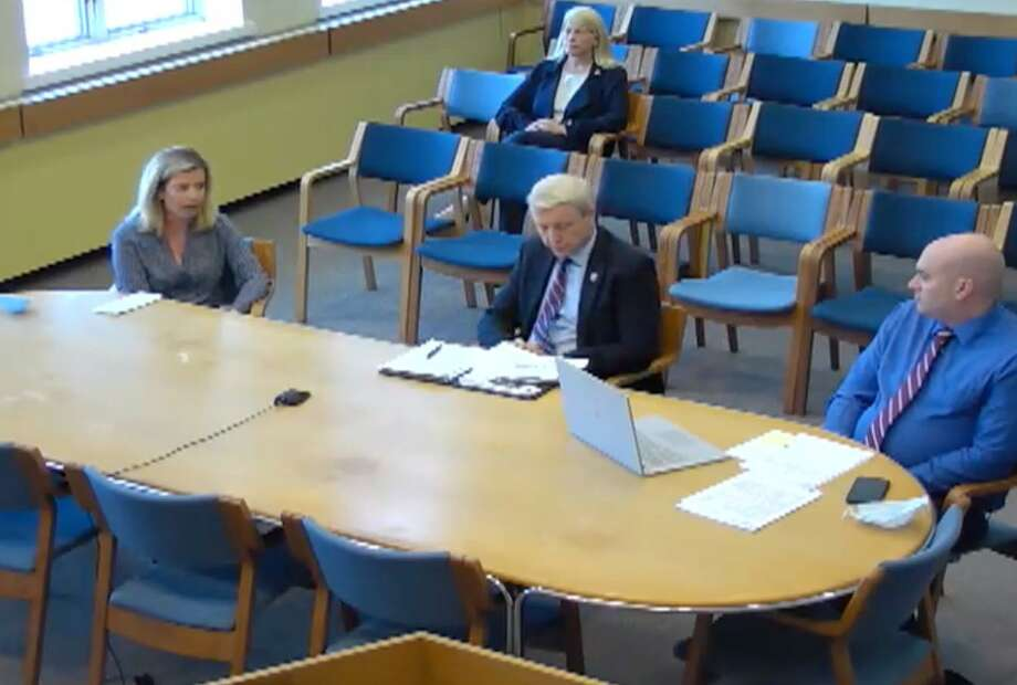 Board of Ed Chairman Tara Ochman, left, Schools Superintendent Dr. Alan Addley, Schools Director of Finance Richard Rudl, and, in back, First Selectman Jayme Stevenson all participated in discussion with the Board of Finance Thursday regarding budget reductions. Photo: Courtesy Darien TV 79