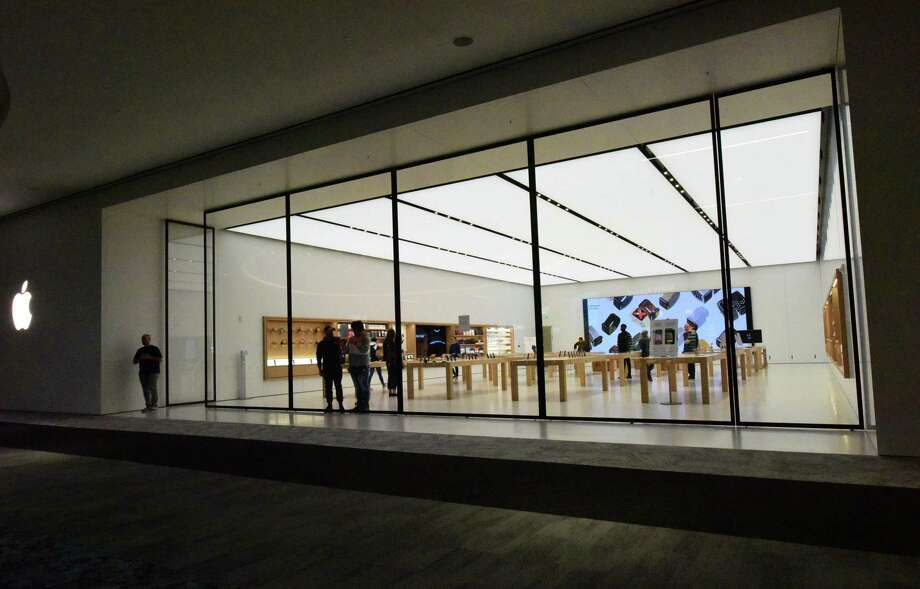 The Apple store in the SoNo Collection mall in Norwalk, Conn., on March 14, 2020. Device spending is predicted to drop by about 16 percent globally in 2020, according to a new forecast of IT spending by consulting and research firm Gartner. Photo: Erik Trautmann / Hearst Connecticut Media / Norwalk Hour