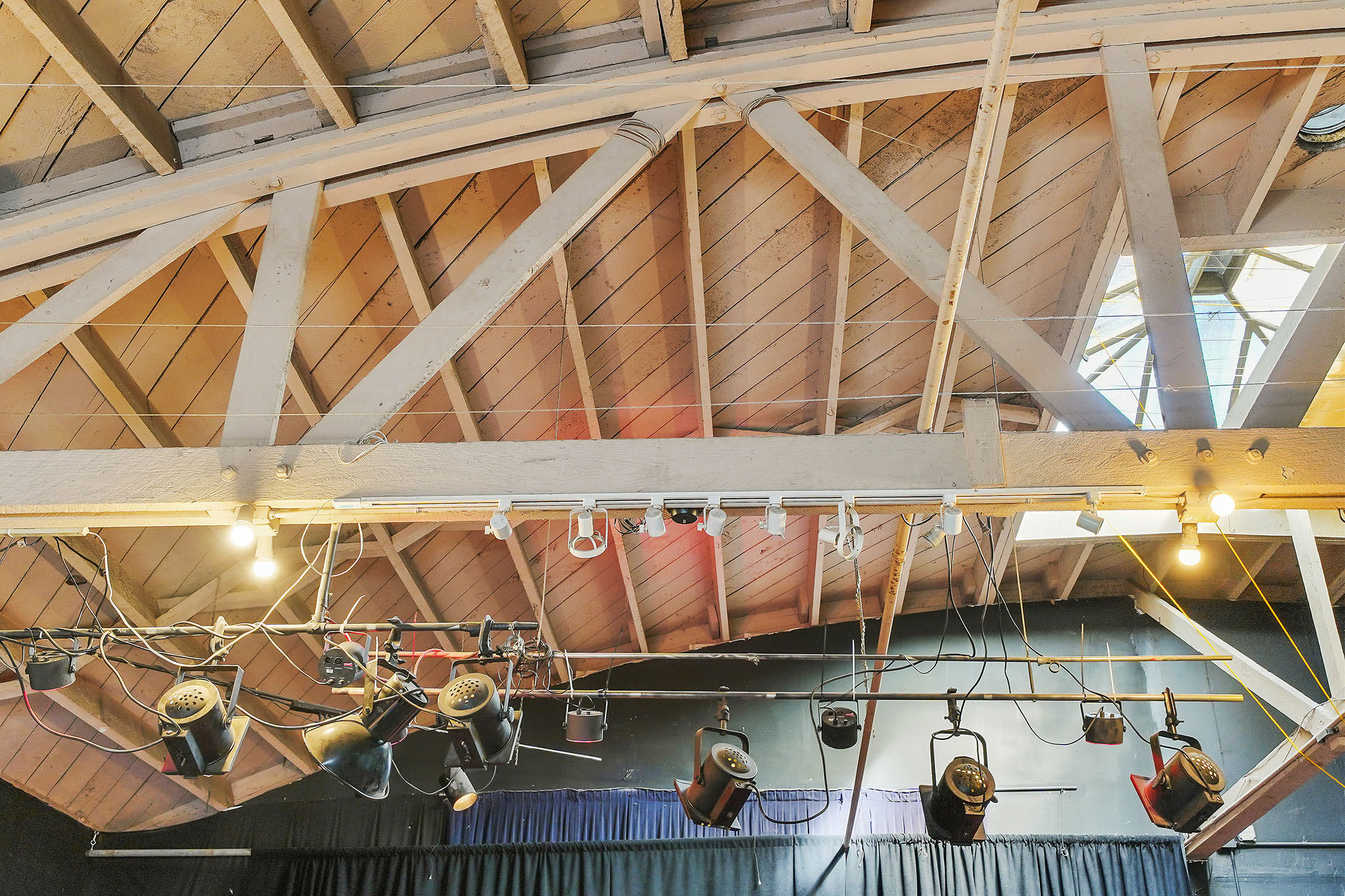The soaring wood frame bowed truss ceiling.
