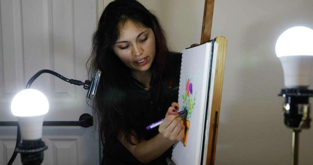 Hannah Garrison livestreams an art lesson from her bedroom studio.