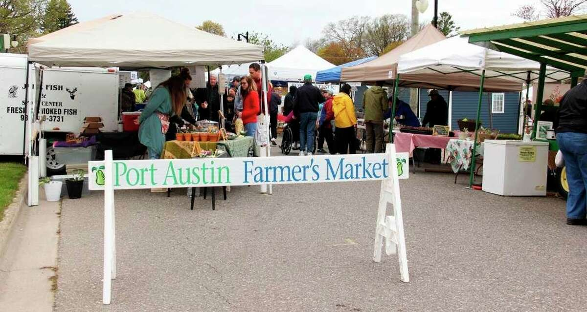 People gathered to buy and sell produce, meat and art products at the 2019 Port Austin Farmer's Market. This year will look different with social distancing guidelines in place. (Tribune File Photo)