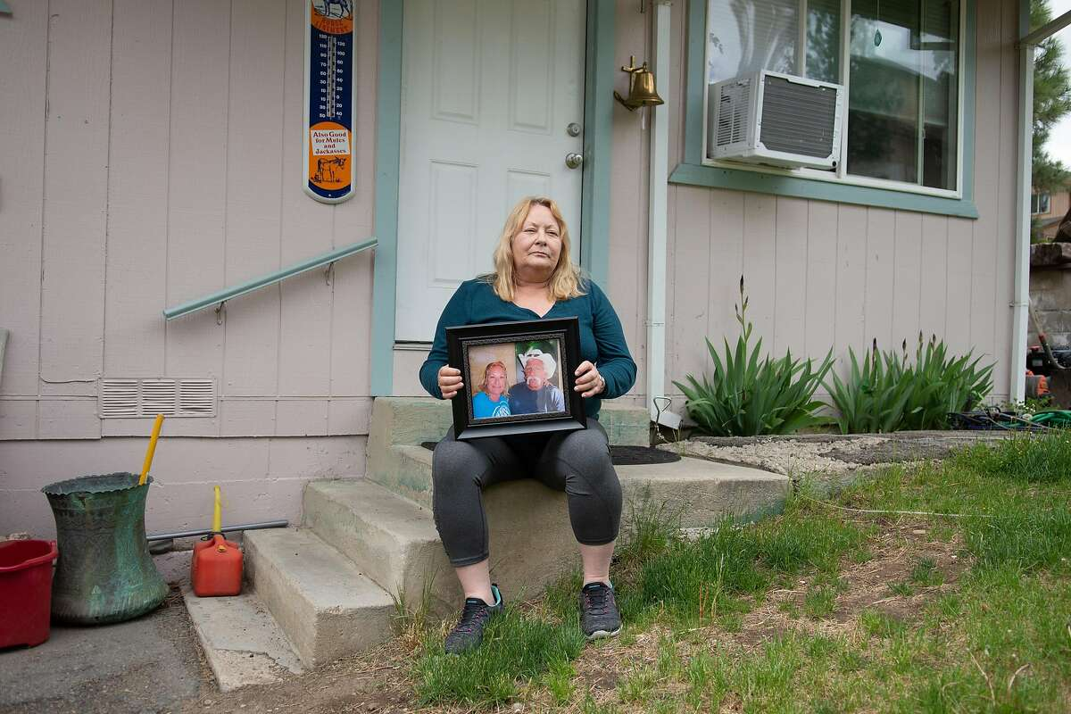 Tracy Henson poses for a portrait outside her home in Portola, Calif. on Thursday, May 14, 2020. Henson's husband, Melford, was a prisoner at the California Institution for Men in Chino, serving time for a DUI. He was scheduled to get out before the end of the year, but he contracted COVID-19 and died at a local hospital on May 6.
