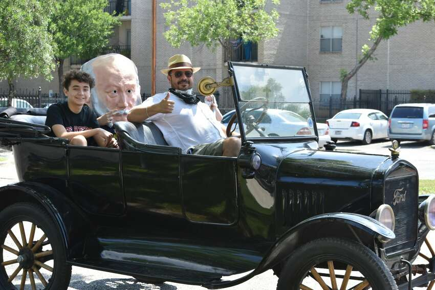 The parade featured several vintage cars. This duo were cruising through the historic neighborhood district in a 1921 Ford Model T.