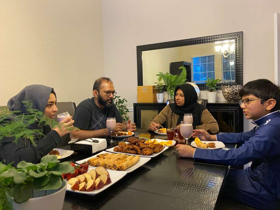 Normally, Katy Muslims break their Ramadan fasts with their mosque communities, but this year the COVID-19 pandemic has closed the mosques. Here, the Shajahan family breaks fast in their home on Wednesday, May 13. Photo: Courtesy Photo