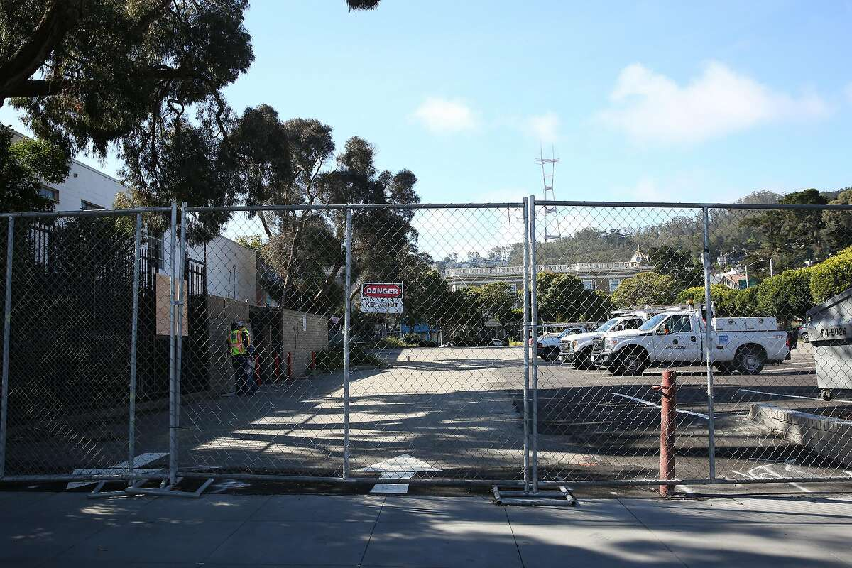 Fencing is seen around the old McDonald's site at the corner of Haight and Stanyan streets on Friday, May 15, 2020 in San Francisco, Calif. San Francisco is preparing the old McDonald's site for a homeless tent site.