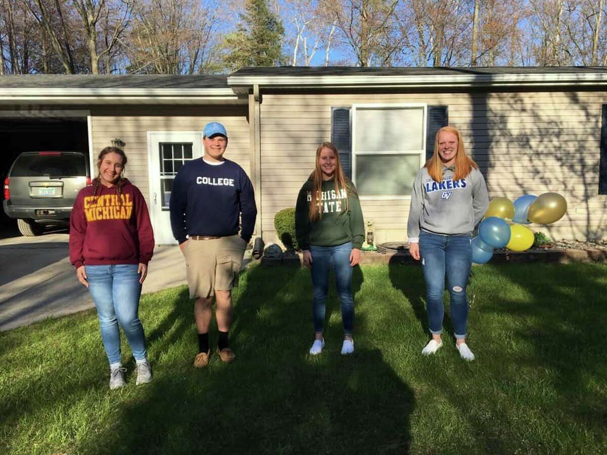 Four Bad Axe High School seniors Melanie Rogers, Ben Shuart, Amanda Nugent and Laken Chapin were shocked to receive $1,500 scholarships right at their homes. (Mackenzie Price Sundblad/Courtesy Photo)
