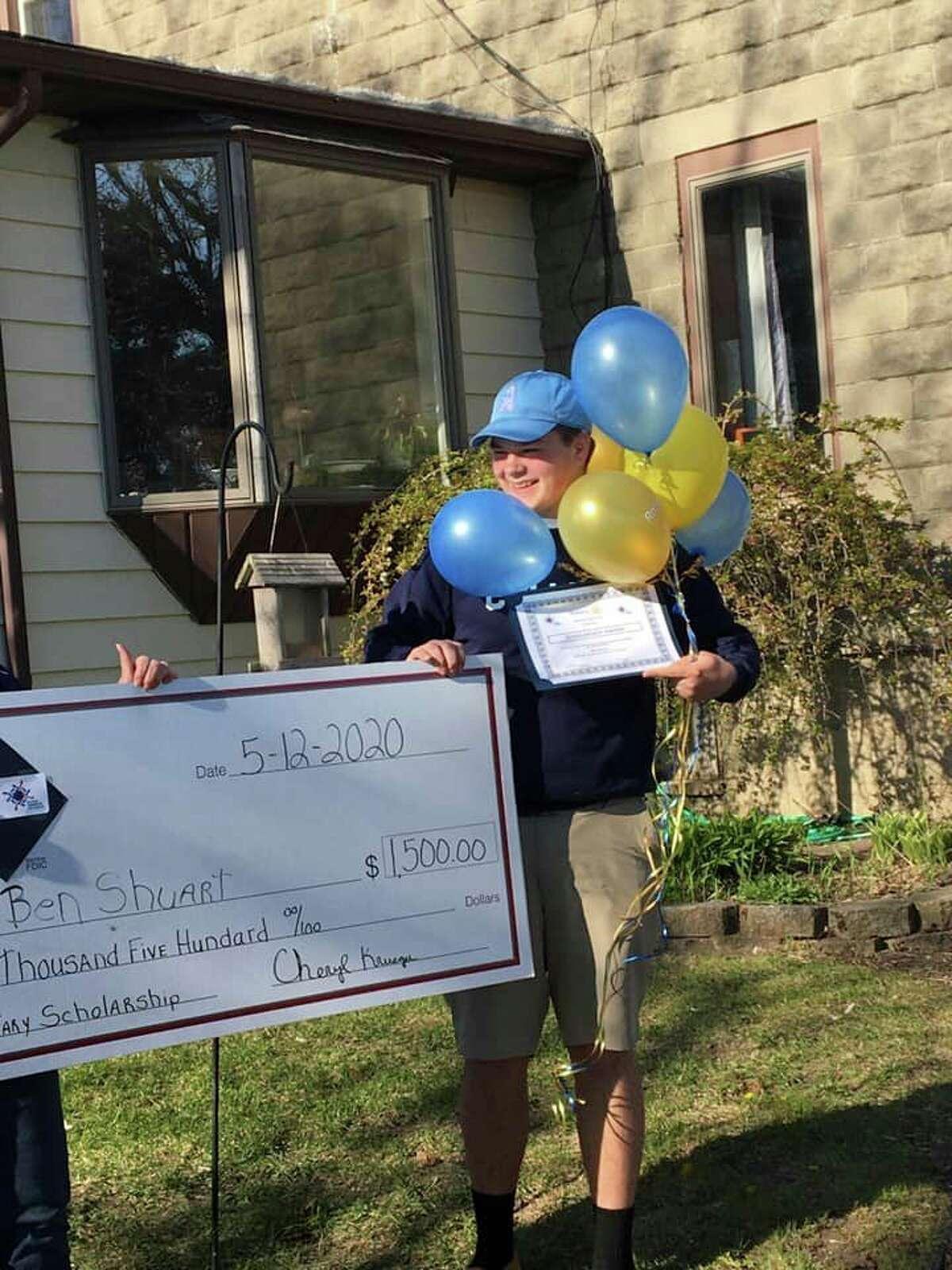 Bad Axe High School senior Ben Shuart was shocked to receive his $1,500 scholarship right outside his home. (Mackenzie Price Sundblad/Courtesy Photo)