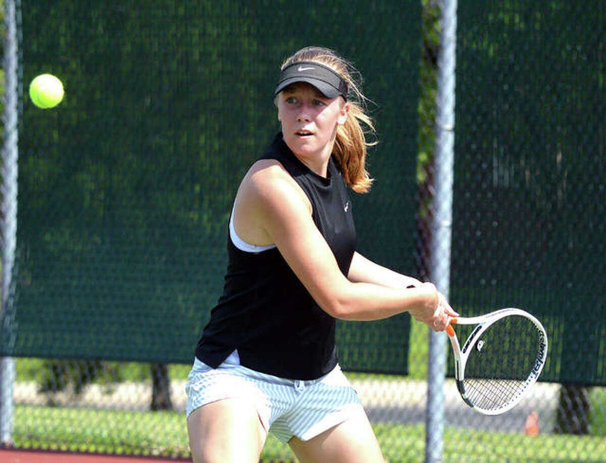 Hannah Colbert, who is now a sophomore at Edwardsville High School, makes a backhand return during her first-round match in women's singles last year in the Edwardsville Open at the EHS Tennis Center.