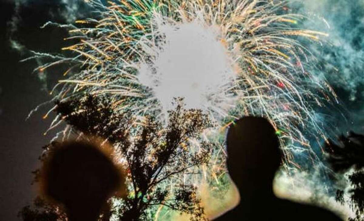 Fireworks fans enjoy the last year's 4th of July show in Alton. The Alton Amphitheater Commission this week unanimously voted to postpone this year's fireworks display along Alton's riverfront and cancel other events scheduled for July 3.