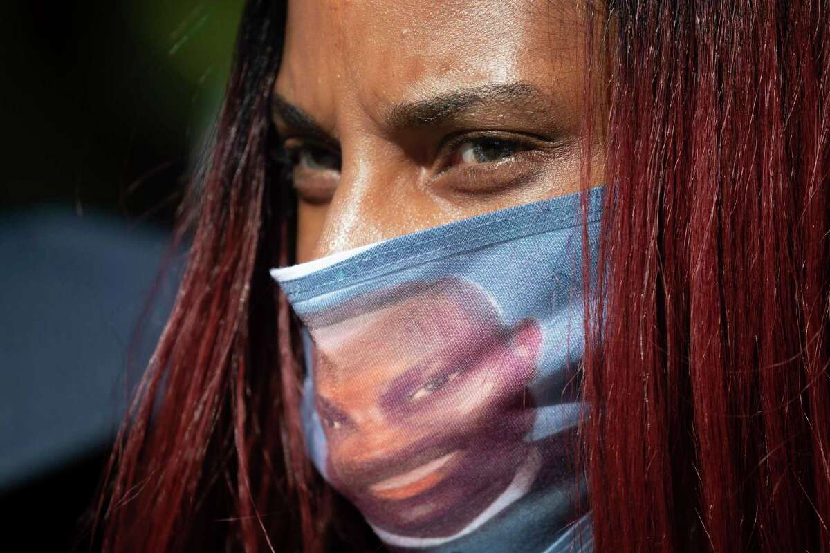 It was a state criminal code that was used to defend not taking action against the men accused of killing Ahmaud Arbery. A woman in Georgia honors him with a face mask.