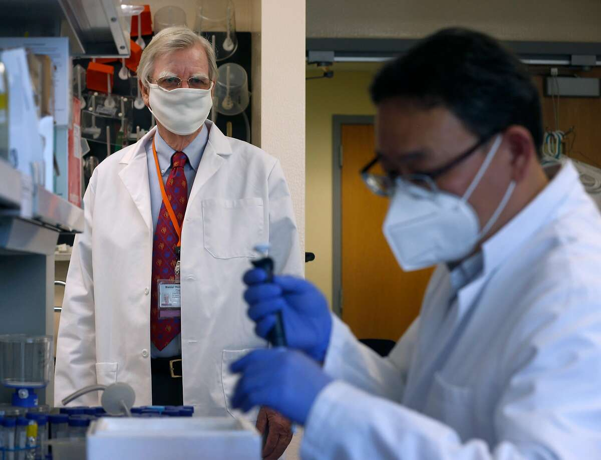 Verndari CEO Dr. Daniel Henderson (left) is leading the development of a coronavirus vaccine patch at the company's biotech lab in Sacramento, Calif. on Thursday, May 7, 2020. At right, Taeho Kim works on the vaccine. Verndari is racing to develop a COVID-19 vaccine administered through a patch worn on the skin.