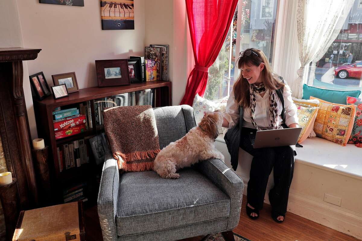 Erin Quinn, Senior Staff Attorney for the Immigrant Legal Resource Center, with her dog Cinnamon in her home in San Francisco, Calif., on Wednesday, May 6, 2020. The Trump administration has spent four years trying to speed up the immigration courts and, thus, deportations. Coronavirus could undo all of it. What�s more, immigrant advocates say the precise policies this administration has pursued will make it all the more difficult to get the courts back to functioning efficiently, potentially pushing hundreds of thousands of cases off for years.