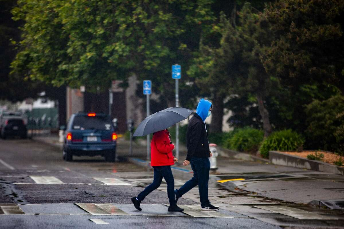 People walk around the closed campus at San Francisco State University on Thursday, May 14, 2020, in San Francisco, Calif. Due to the coronavirus pandemic, the California State University system will conduct fall semester primarily online.