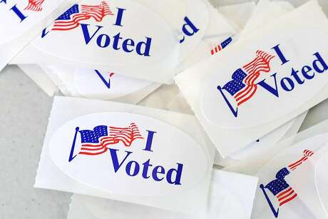 """I Voted"" stickers at a polling station on the campus of the University of California, Irvine, on Nov. 6, 2018, in Irvine, Calif. (Robyn Beck/AFP/Getty Images/TNS)"