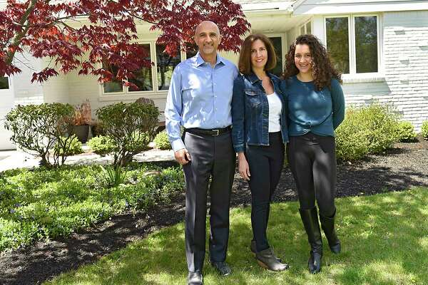 Fardin Sanai stands outside his home with his wife Michele Susko and their daughter Roya, right, on Wednesday, May 13, 2020 in Albany, N.Y. The family are observant Baha'is, one of about 50 in the Capital Region. (Lori Van Buren/Times Union)