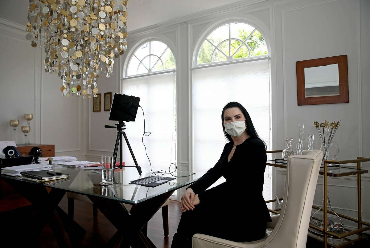 Micha Star-Liberty, an attorney who is president of Consumer Attorneys of California, poses for a portrait in her home in Oakland, Calif., on Tuesday, May 12, 2020. Star-Liberty has been practicing law at home during the coronavirus pandemic.