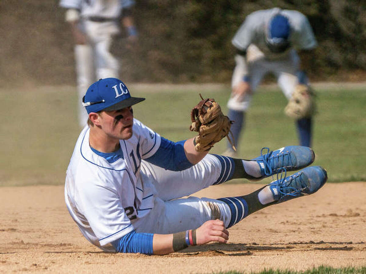 Lewis and Clark third baseman Adam Stilts looks to convince the umpire on a close tag during a game against Kirkwood College in March in Godfrey. The season was cut short a few days later when the NJCAA cancelled spring sports because of the COVID-19 pandemic.