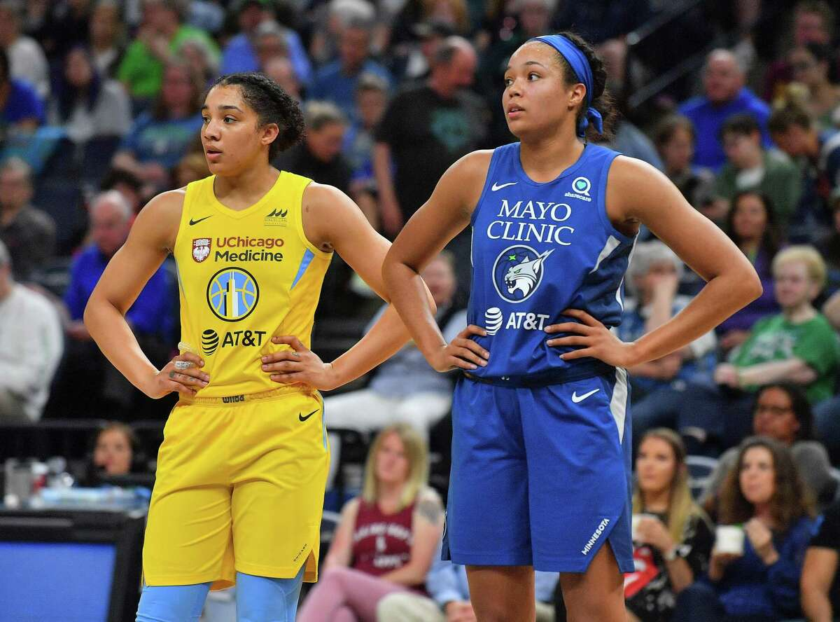 MINNEAPOLIS, MINNESOTA - MAY 25: Gabby Williams #15 of the Chicago Sky and Napheesa Collier #24 of the Minnesota Lynx stand on the court during their game at Target Center on May 25, 2019 in Minneapolis, Minnesota. The Lynx defeated the Sky 89-71. NOTE TO USER: User expressly acknowledges and agrees that, by downloading and or using this photograph, User is consenting to the terms and conditions of the Getty Images License Agreement. (Photo by Sam Wasson/Getty Images)