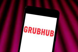 BRAZIL - 2019/05/30: In this photo illustration a Grubhub logo seen displayed on a smartphone. (Photo Illustration by Rafael Henrique/SOPA Images/LightRocket via Getty Images)