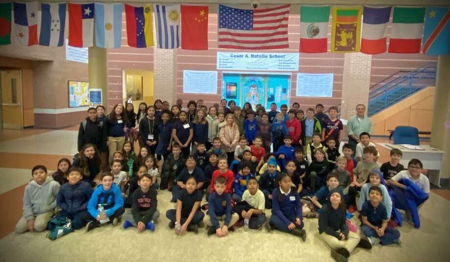 Riverfield and Cesar Batalla students together in the Cesar Batalla foyer during their chess program on February 11, 2020. Photo: / Matt Tuccillo