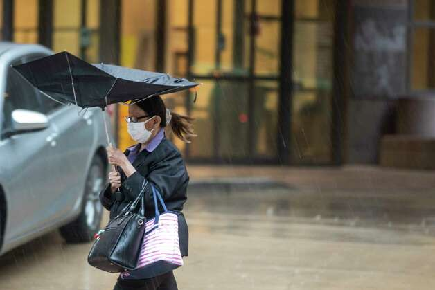 Heavy rain comes down on pedestrians in the Texas Medical Center on Friday, May 15, 2020 in Houston. Thunderstorms are forecast through  Saturday. Photo: Brett Coomer, Staff Photographer / © 2020 Houston Chronicle