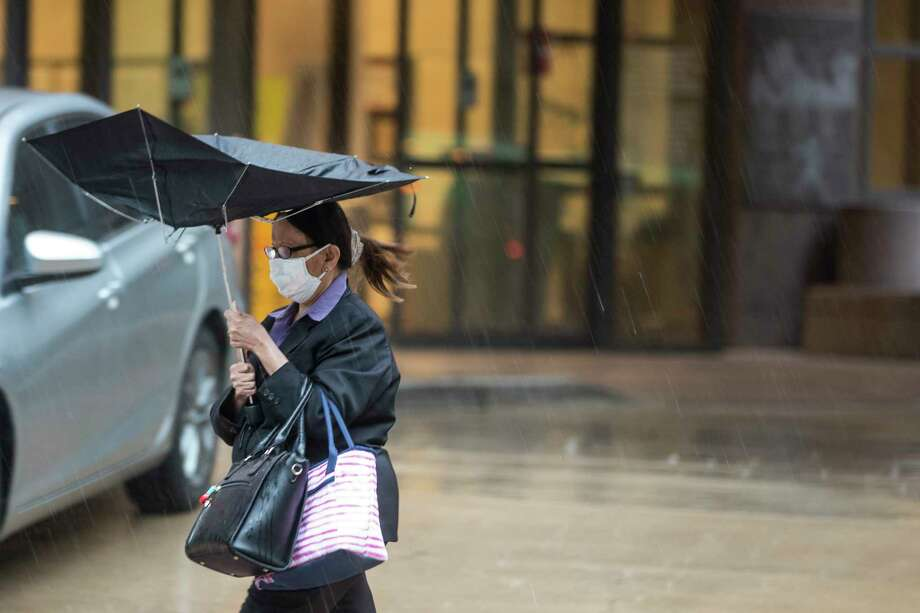 Heavy rain comes down on pedestrians in the Texas Medical Center on Friday, May 15, 2020 in Houston. Photo: Brett Coomer, Staff Photographer / © 2020 Houston Chronicle