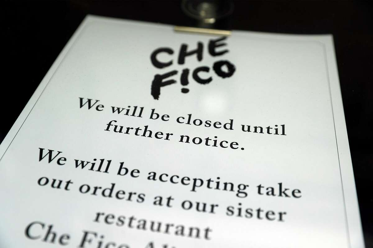 Sign on entrance to Che Fico in San Francisco, Calif., on Thursday, May 14, 2020. Che Fico has been closed since the start of shelter in place order and owners David Nayfeld and Matt Brewer have no plans on when they might reopen the restaurant.