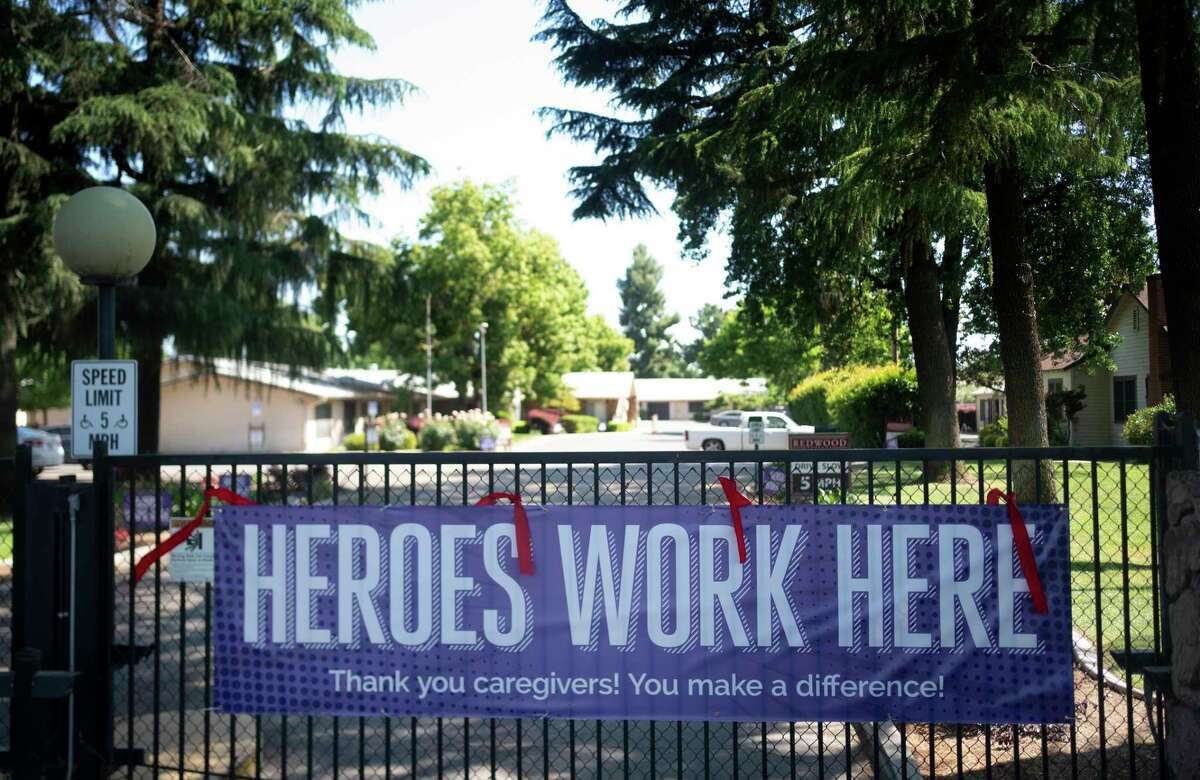 Supporting health care workers signs are placed outside of the Redwood Springs Health Center's nursing home.