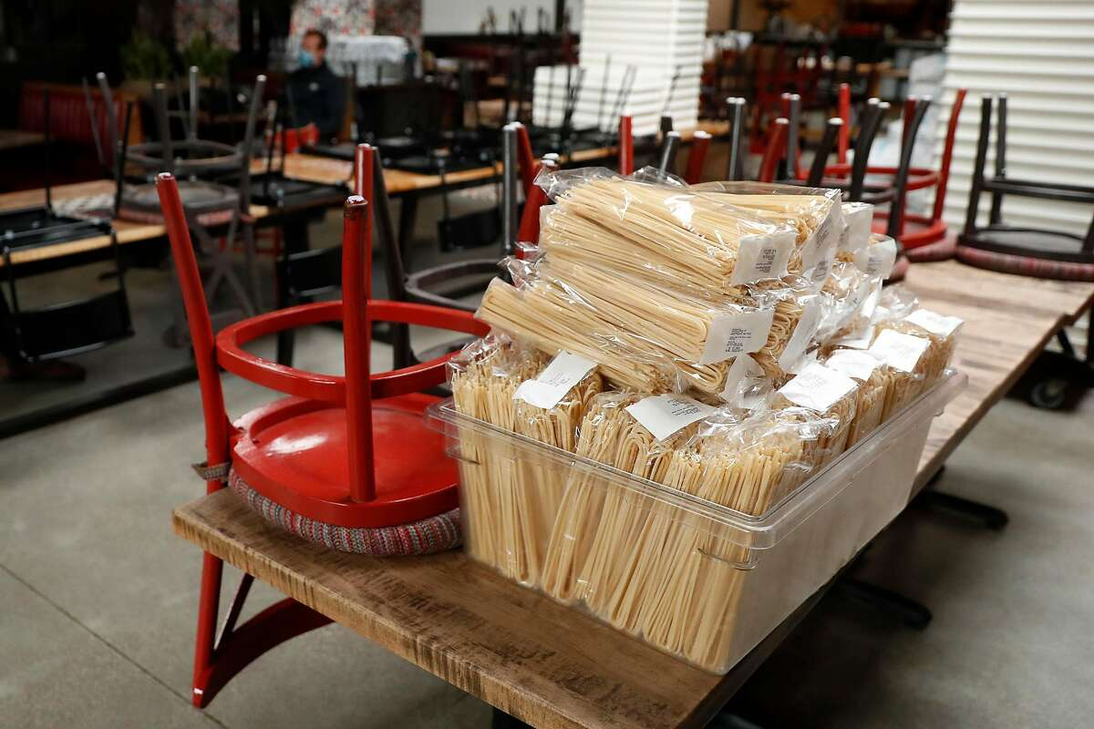 Bags of pasta sit on a table at Che Fico in San Francisco, Calif., on Thursday, May 14, 2020. Che Fico has been closed since the start of shelter in place order and owners David Nayfeld and Matt Brewer have no plans on when they might reopen the restaurant.