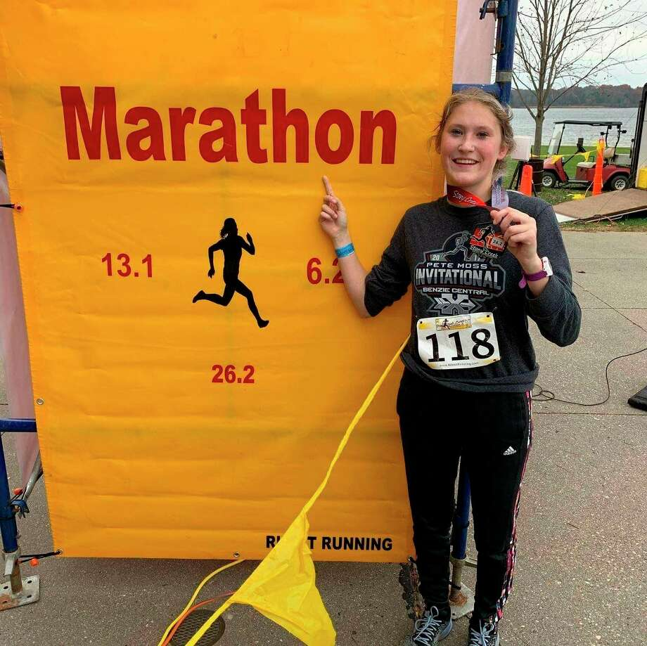 Manistee's Noelle Fink accomplished her goal of completing a marathon before her 18th birthday, placing fifthat the Stony Creek Marathon in November with an official time of 4 hours, 20 minutes and 48 seconds. (Courtesy photo)