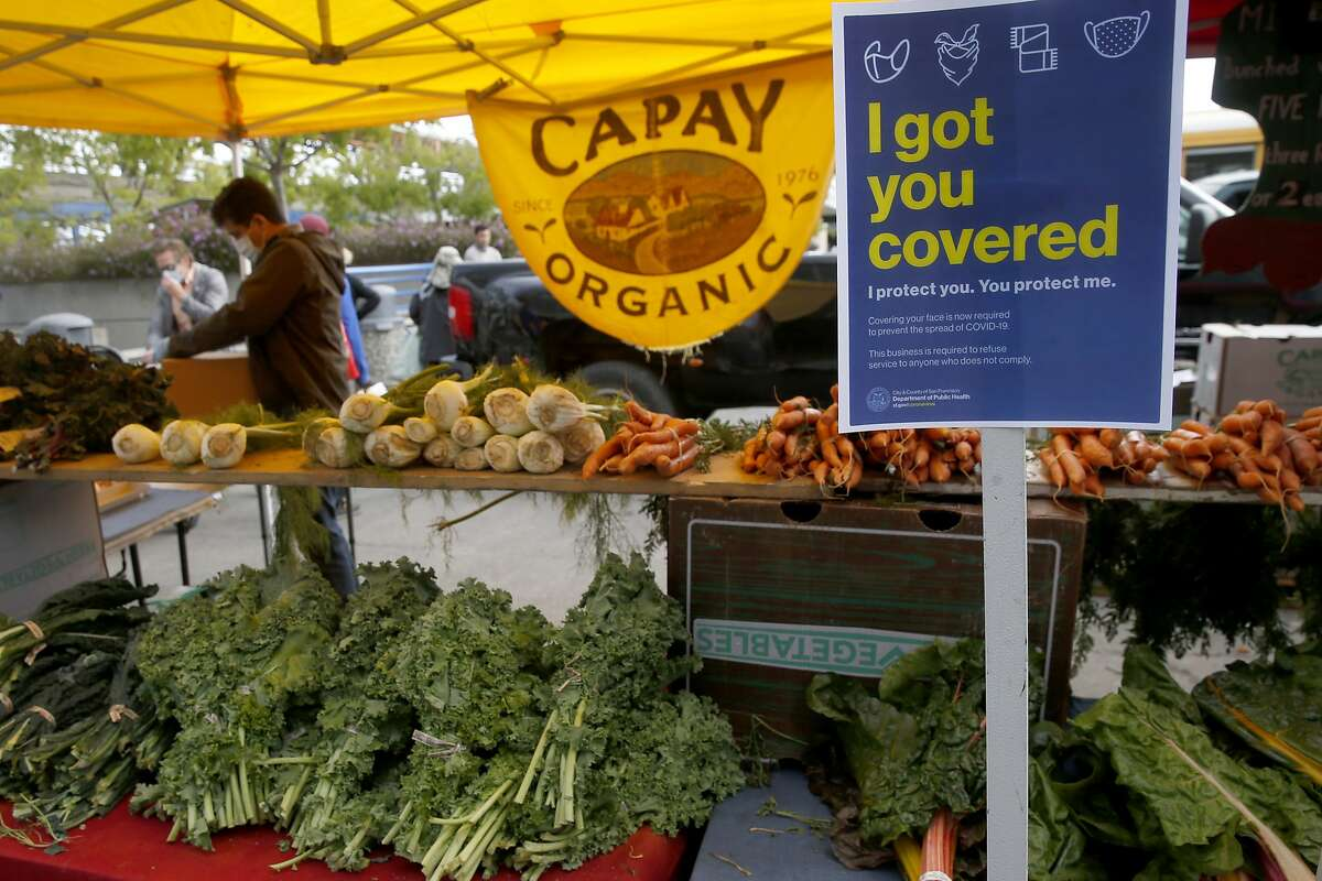 Fresh produce is on display at the Ferry Plaza Farmers Market in San Francisco. The famous market remains open during the new stay-at-home order as an essential service.