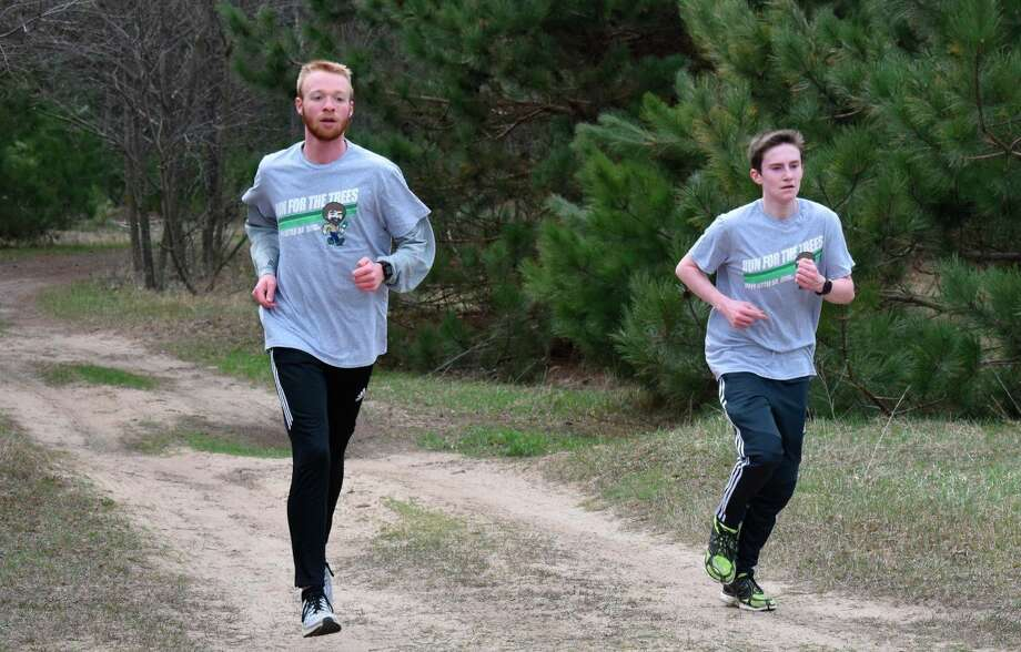 Bear Lake students Hunter Bentley and Kaden Forward take part in the Michigan Department of Natural Resources Happy Little 5K Run for the Trees event. The run was supposed to take place near Earth Day, but the coronavirus pandemic caused it to be canceled. Students used social distancing to run it and earn 11 trees for Michigan State Parks. (Courtesy photo)
