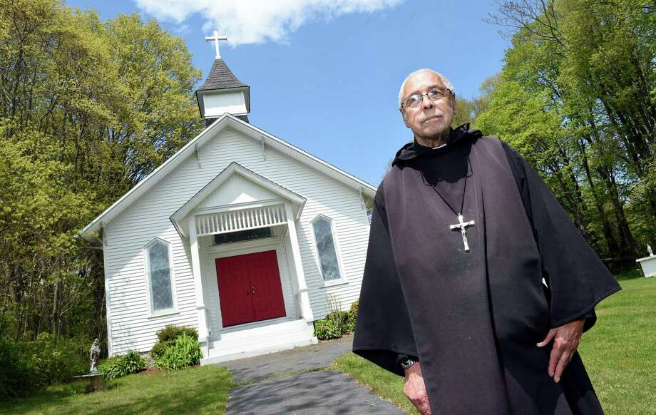 Father Bernard Champagne  in front of Our Lady of Sorrows Church in Orange on May 15, 2020. Photo: Arnold Gold / Hearst Connecticut Media / New Haven Register