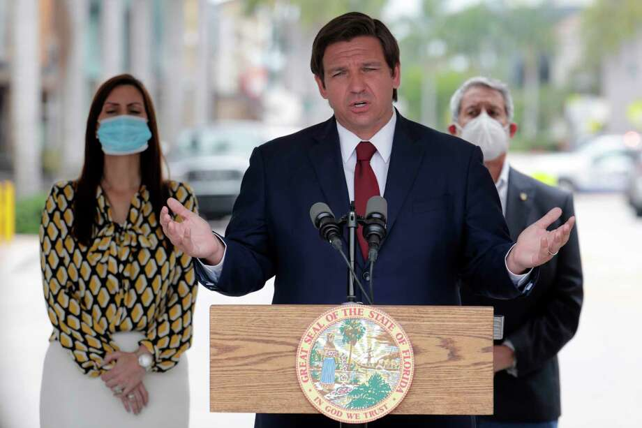 Florida Gov. Ron DeSantis speaks at a news conference during the new coronavirus pandemic, Thursday, May 14, 2020, in Doral, Fla. DeSantis has signed an executive order for the reopening of Miami-Dade and Broward counties on May 18. Photo: Lynne Sladky, AP / Copyright 2020 The Associated Press. All rights reserved.