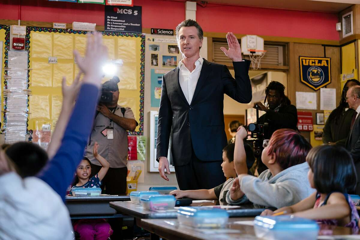Governor Gavin Newsom talks with students in a classroom during a campaign stop in support of state proposition 13 at Manzanita SEED Elementary School in Oakland, California, on Monday, March 2, 2020.