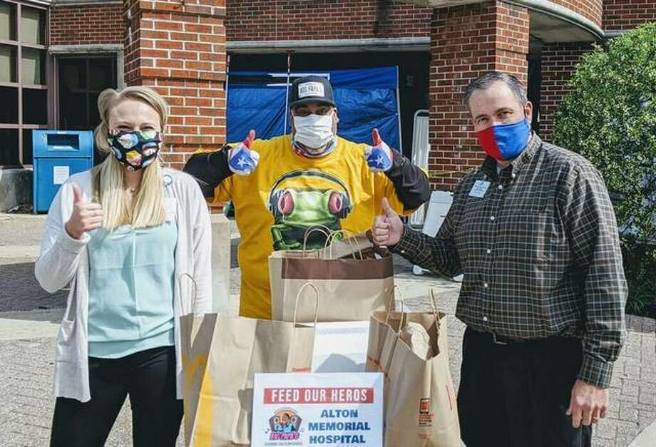 Greg Horta, also known as Big Papa G, is pictured with members of Alton Memorial Hospital. The DJ and entertainment company has provided free food to healthcare workers and first responders during the COVID-19 pandemic.