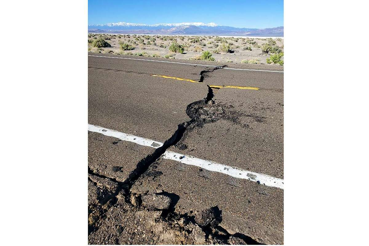This photo provided by the Nevada Highway Patrol shows earthquake damage that has U.S. Highway 95 closed for repairs after a magnitude 6.5 earthquake struck early Friday, May 15, 2020 in a remote area west of Tonopah. Trooper Hannah DeGoey and local sheriff's offices reported no injuries following the 4 a.m. temblor. DeGoey said crews were working to reopen the main highway between Las Vegas and Reno. (Nevada Highway Patrol via AP)