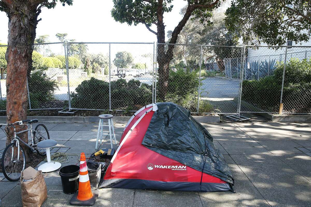 A tent on Waller Street is seen next to the the old McDonald's site at the corner of Haight and Stanyan streets on Friday, May 15, 2020 in San Francisco, Calif. San Francisco is preparing the old McDonald's site for a homeless tent site.