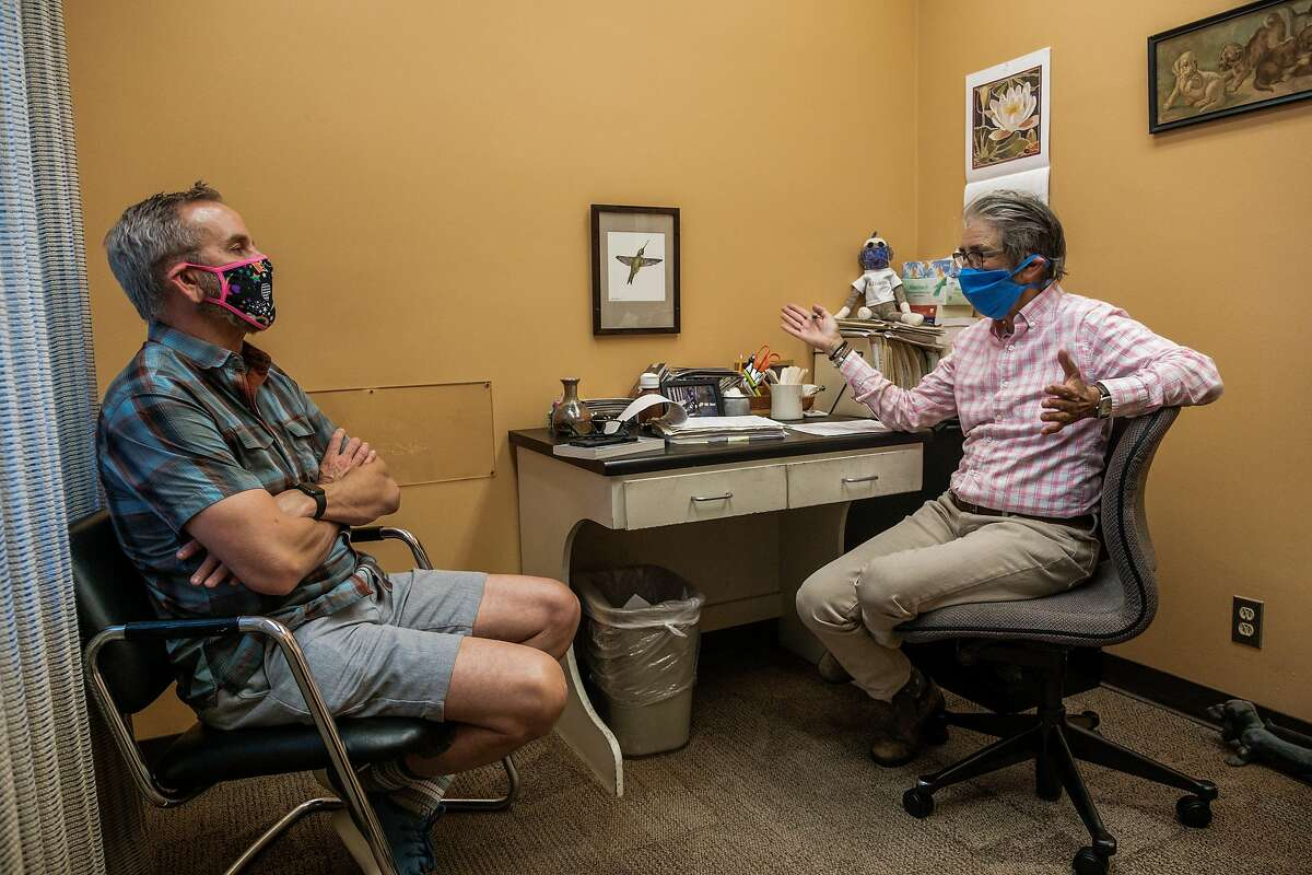 Dr. Lisa Capaldini speaks with patient Wayne Sobon in her office in San Francisco, Calif. on Friday, May 15, 2020.